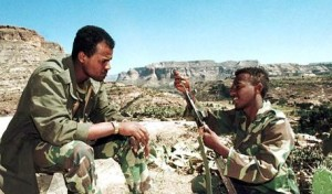 ERI01 - 19990213 - ZALA ANBESA, ERITREA - Eritrean soldiers clean their weapons, Saturday, 13 February 1999 on the central front line at Zala Anbesa where all was quiet in the border war between Eritrea and Ethiopia. The Ethiopian government said 12 February that more than 7,000 Eritrean soldiers had been killed or wounded since fighting flared up last week between the two sides.     EPA PHOTO         AFP/AMR NABIL